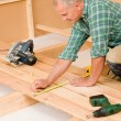 Stock Photo: Handymhome improvement wooden floor renovation