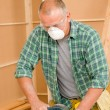 Handyman sanding wooden board diy home renovation — Stock Photo