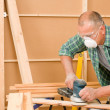 Handyman sanding wooden board diy home renovation — Stock Photo #6879447