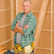 Handyman mature professional diy home improvement — Stock Photo #6879448