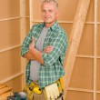 Handyman mature professional diy home improvement — Stock Photo