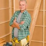 Handyman mature professional diy home improvement — Stock Photo