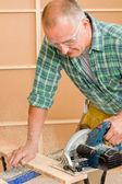 Handyman home improvement cut wood with jigsaw — Stock Photo