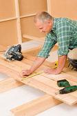 Handyman home improvement wooden floor renovation — Stock Photo