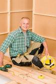 Handyman home improvement wooden floor screwdriver — Stock Photo