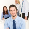 Business team handsome businessman with colleagues — Stock Photo