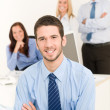 Business team handsome businessman with colleagues — Stock Photo #6935457