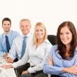 Business team happy sit in line behind table — Foto Stock