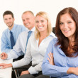 Business team happy sit in line behind table — Foto de Stock
