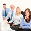 Business team happy sit in line behind table — Stock Photo #6935487