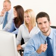 Business team happy sit in line behind table — Stock Photo