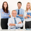 Business team happy mature manager with colleagues — Stock Photo