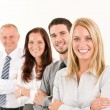 Business team happy standing in line portrait - Stock Photo