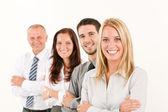 Biznes drużyna stojący szczęśliwy w linii portret — Zdjęcie stockowe