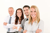 Business team happy standing in line portrait — Stock Photo