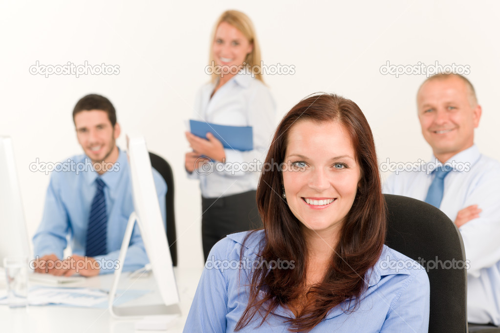 Business team pretty businesswoman portrait happy colleagues around table — Stock Photo #6935467