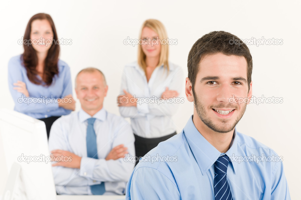 Business team close-up of young businessman with attractive happy colleagues — Stock Photo #6935516