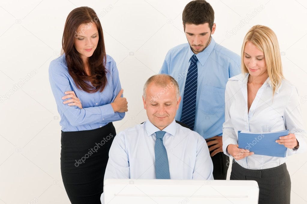 Business team mature businessman with attractive colleagues looking computer — Stock Photo #6935517