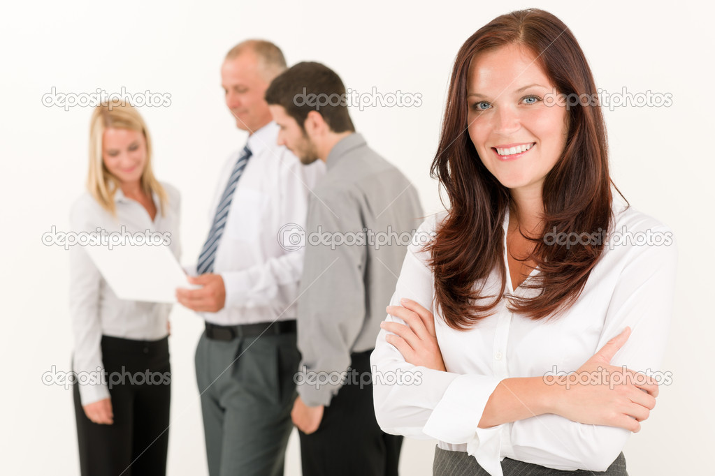 Business team attractive woman with colleagues discussing in the back — Stock Photo #6935520