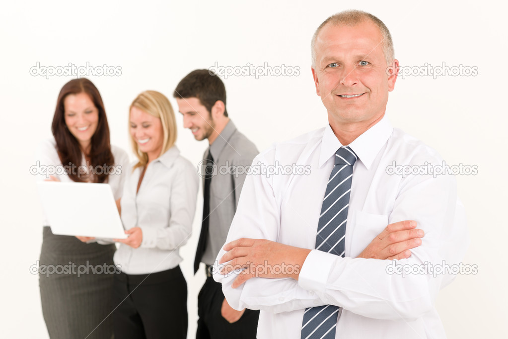 Business team mature man with happy colleagues posing in back — Stock Photo #6935527