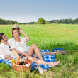 Picnic - Romantic couple in sunny meadows - Stock Photo