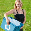 Recycling paper box businesswoman in sunny meadow — Stock Photo