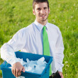 Recycling paper box businessman in sunny meadow — Stock Photo