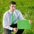 Green energy young businessman hold recycling sign — Stock Photo #7085576