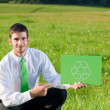 Green energy young businessman hold recycling sign — Stock Photo