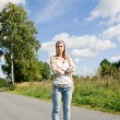 Inline skating young woman on sunny asphalt road — Stock Photo #7085641