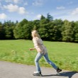 Inline skating young woman speed workout sunny — Stock Photo #7085655
