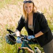 Mountain biking young woman sportive sunny meadows — Stock Photo #7085673
