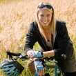 Mountain biking young woman sportive sunny meadows — Стоковая фотография