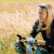 Mountain biking young woman sportive sunny meadows — Photo