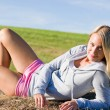 Sportive young woman relax on hay bales — Stock Photo #7088473