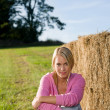 Sportive young woman relax by bales sunset — Stock Photo #7088493