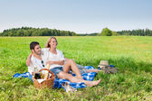 Picnic - Romantic couple in sunny meadows — Stock Photo
