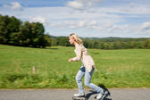 Inline skating young woman speed workout sunny day — Stock Photo