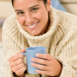 Winter portrait of happy woman holding cup of coffee — Stock Photo #7233440