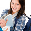 Student teenager girl with schoolbag read books - Stock Photo