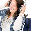 Smiling female teenager enjoy music headphones — Stock Photo #7234202