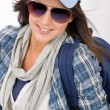 Happy female teenager wear cool outfit sunglasses - Stock Photo