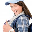 Happy female teenager cool outfit thumb-up — Stock Photo