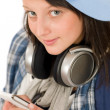 Royalty-Free Stock Photo: Smiling teenager girl enjoy music with headphones