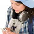 Smiling teenager girl enjoy music with headphones — Stock Photo
