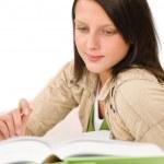 Student teenager girl write homework with book — Stock Photo