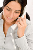 Thoughtful businesswoman attractive calling phone — Stock Photo