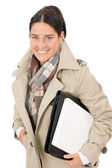 Autumn fashion businesswoman holding briefcase — Foto de Stock