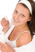 Acne facial care teenager woman apply cream — Stock Photo