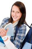 Student teenager girl with schoolbag read books — Stock Photo